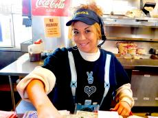 Friendly kitchen staff at Photo's Hot Dogs in Palatine