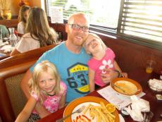 Family enjoying lunch at Plainfield's Delight Restaurant in Plainfield