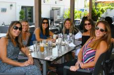 Friends enjoying the outdoor patio at Plateia Mediterranean Kitchen & Bar in Des Plaines