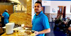 Friendly server at QP Greek Food With a Kick in Hoffman Estates