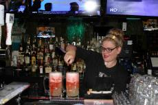 "Friendly bar server preparing ""Slammers"" at Rocky's American Grill in Prospect Heights"