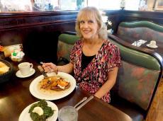 Customer enjoying dinner at Rose Garden Cafe in Elk Grove Village