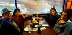Family enjoying dinner at Rose Garden Cafe in Elk Grove Village