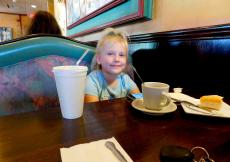 Young customer enjoying soup at Rose Garden Cafe in Elk Grove Village