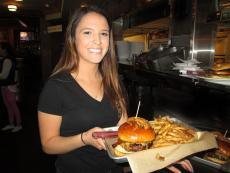 Server with famous burgers at North Branch Pizza and Burger Co. in Glenview