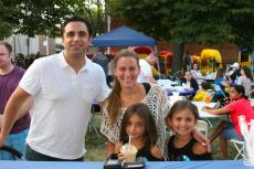 Family enjoying the Lincoln Square Greek Fest at St. Demetrios in Chicago