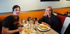 Couple enjoying breakfast at Teddy's Diner in Elk Grove Village