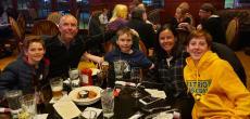 Family enjoying dinner at Woodfire Tavern in Long Grove