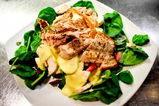The famous Salmon & Spinach Salad at Xando Cafe in Hickory Hills