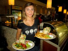 Friendly server with delicious wraps at Xando Cafe in Hickory Hills
